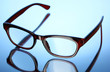 Beautiful glasses on blue background