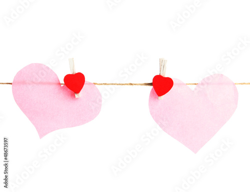 two paper hearts on rope, isolated on white