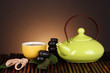 Chinese tea ceremony on bamboo table on brown background