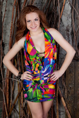 a beautiful redheaded girl is in a swimming suit