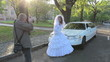 photo of  just marrying  woman near car. Wedding