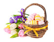 Easter eggs in a basket and spring flowers.