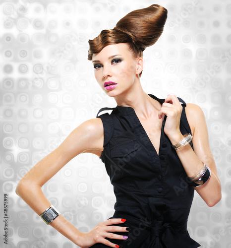 Beautiful woman dressed in black dress