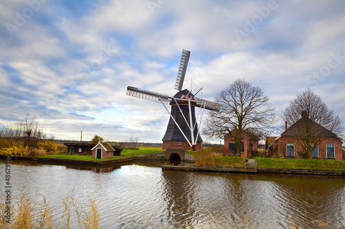 Dutch windmill by canal