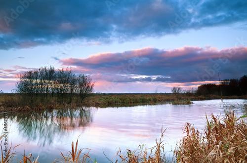 dramatic sky at sunrise bu pond