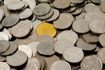 Gold coin around silver coin