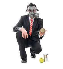 Business man with gas mask holding conserve food