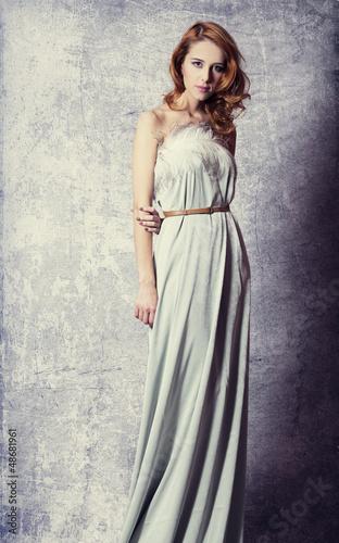 Beautiful woman posing in a long dress