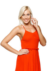 Smiling woman using cell phone looking at camera
