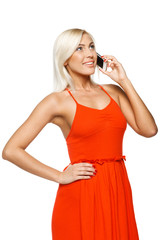 Smiling woman using cell phone looking up