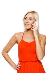 Thinking woman using cell phone and looks to side