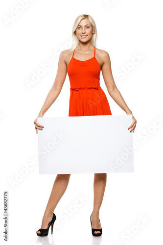 Woman in full length holding empty banner