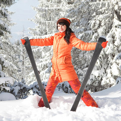 Happy girl with ski in the winter landscape