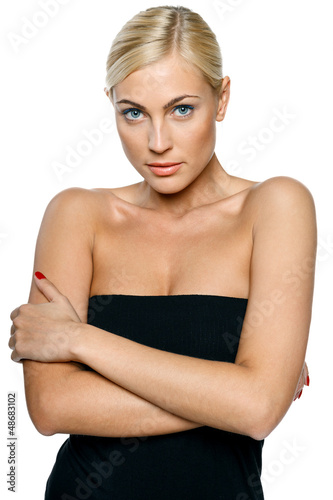 Woman in black top embrace herself and shiver with cold