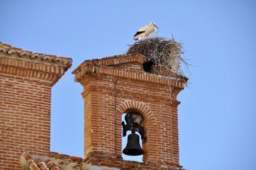 White stork on a belfry, Alcala de Henares, Madrid (Spain)
