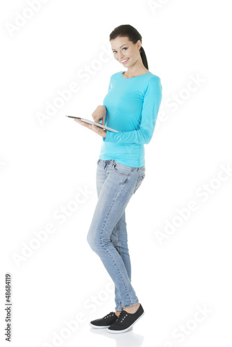 Young pretty woman working on tablet computer