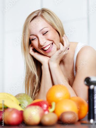 Pretty girl in the kitchen loves healthy food to lose weight