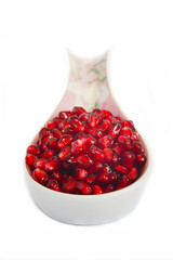 Punica granatum, pomegranate seeds in the spoon