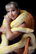 The beautiful woman with the big yellow snake