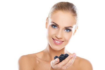 Smiling healthy woman with blackberries