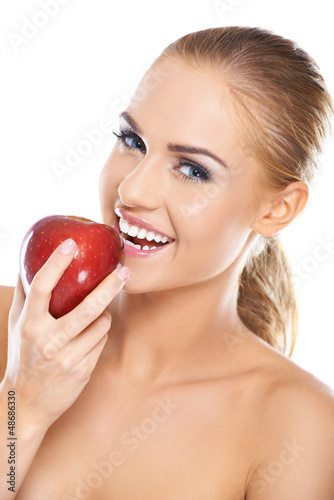 Laughing woman with a red apple