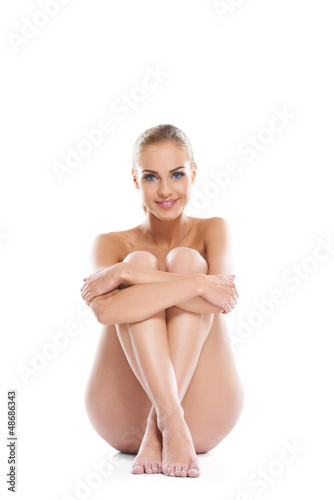 Woman posing implied nude