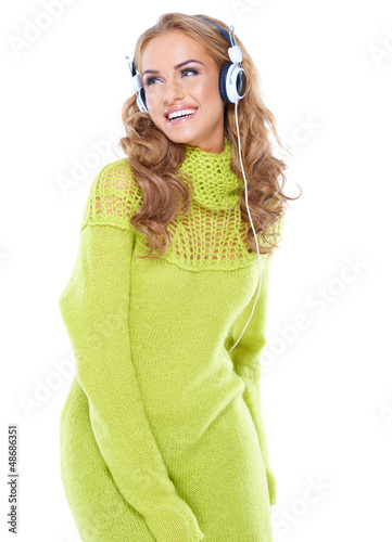Laughing woman enjoying her music
