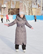 Woman is skating at an ice rink