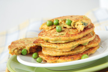 Pea flour fritters with green peas, carrots