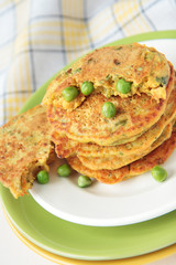 Pea flour fritters with green peas and carrots