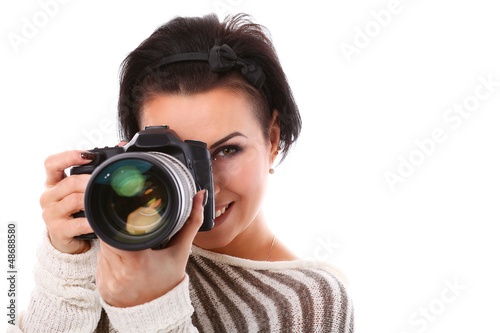 Young happy woman with camera