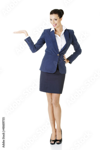 Businesswoman showing copy space on her palm