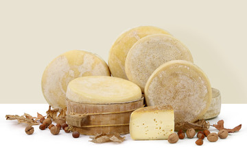composition of cheese with walnuts and hazelnuts and autumn leav