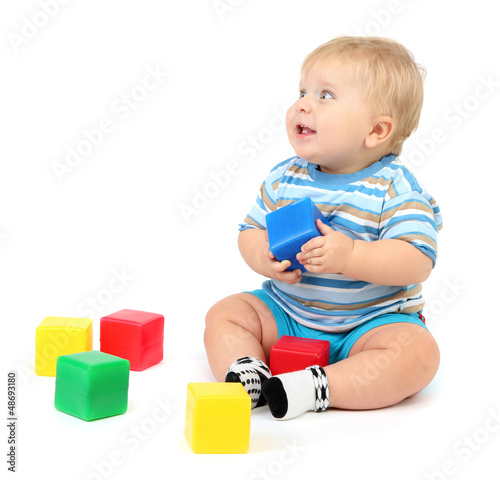 Little boy playing with multicolor blocks