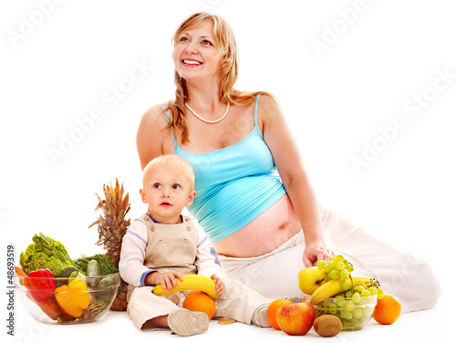 Family pregnant woman preparing food .