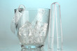 Glass ice bucket on light blue background