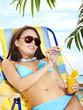 Girl in bikini drinking cocktail.