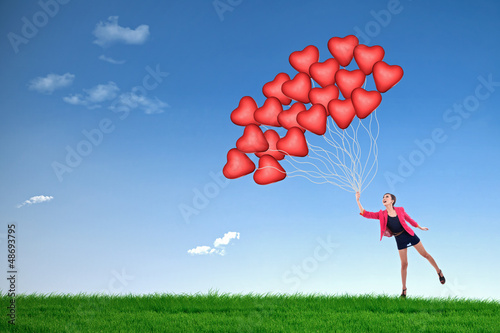 Girl hold red heart balloons
