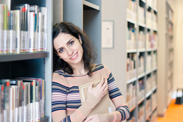 Pretty young woman in the library