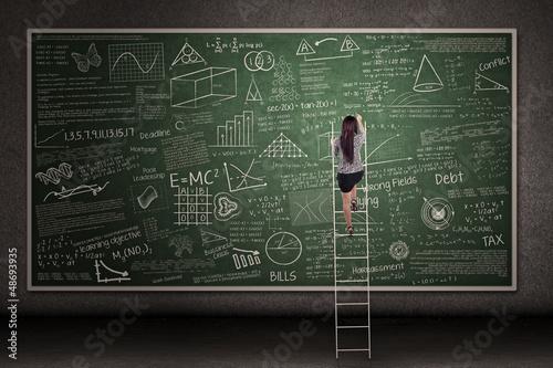 Hand drawn chalkboard with woman climb