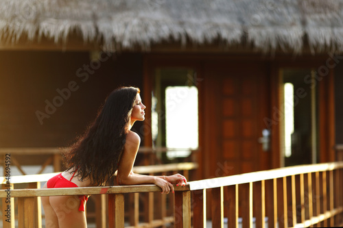 Woman near tropical hotel