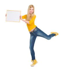 Full length portrait of happy student girl showing blank board