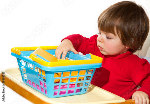 Little girl playing with colored toys