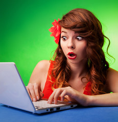 Surprised young woman at a computer