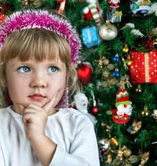 Little child girl near Christmas tree. Happy new year