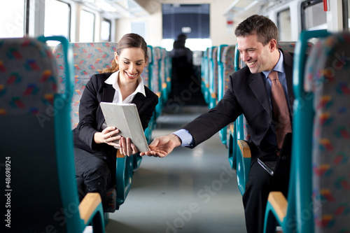 Businesswoman showing her colleague something on her tablet comp