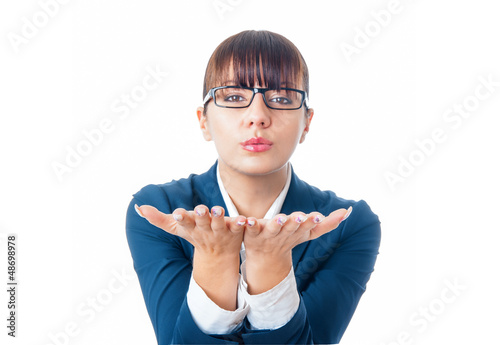 Happy business woman blowing with open hand something
