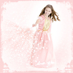 Young girl dressed as a princess with magic wand