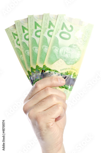 Hand Holding New Canadian Twenty Dollar Bills Isolated