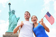 Tourists travel couple at Statue of Liberty, USA - 48700734